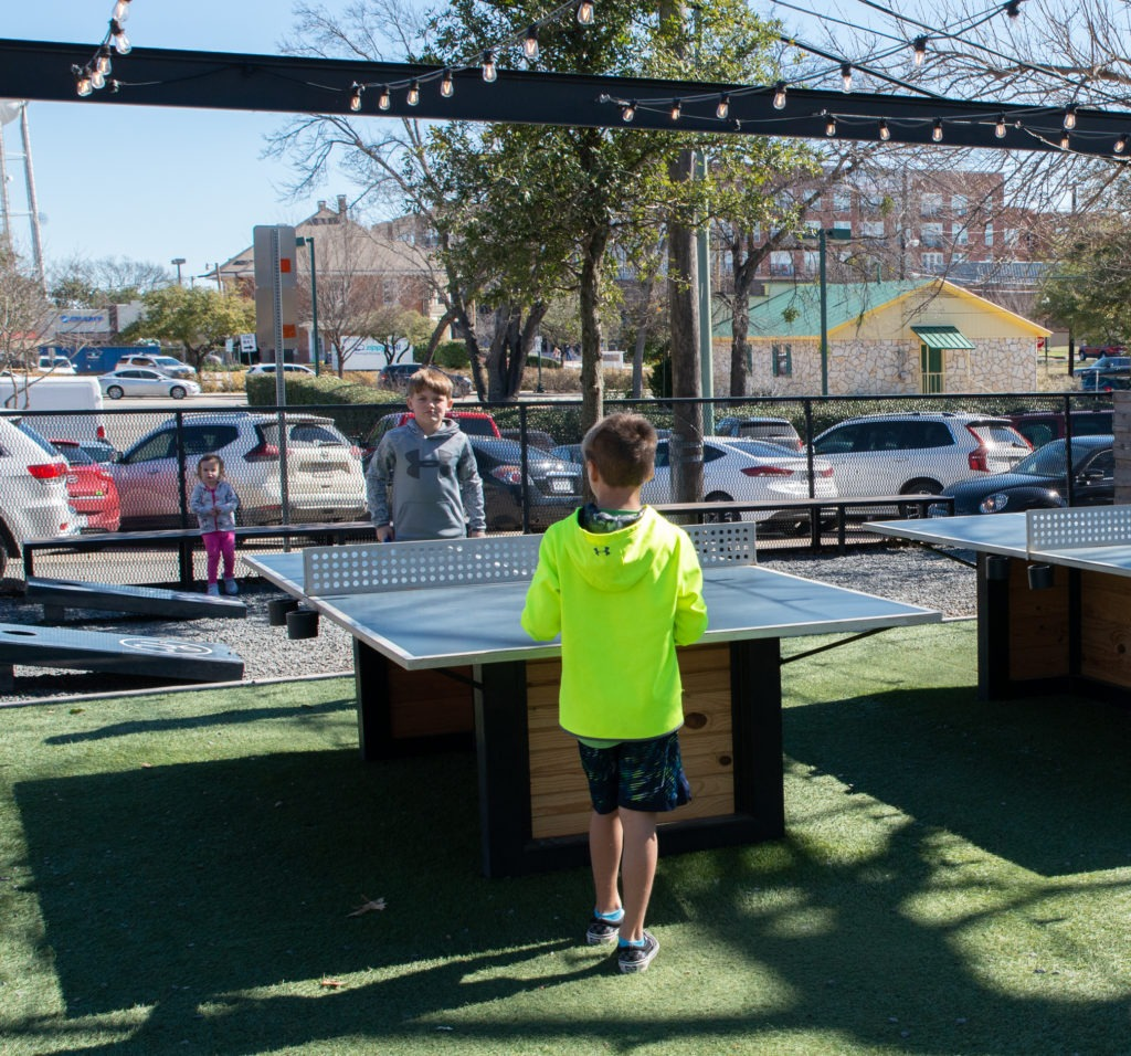 Playing ping pong at The Yard McKinney Texas